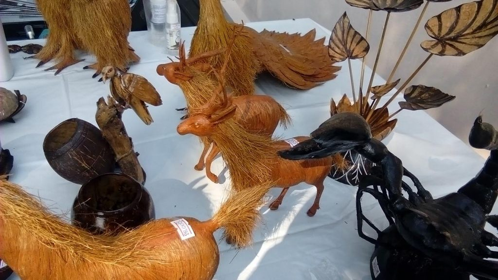 Participants of the coconut handiwork course have their products put up on display. Photo: Myanmar Digital News