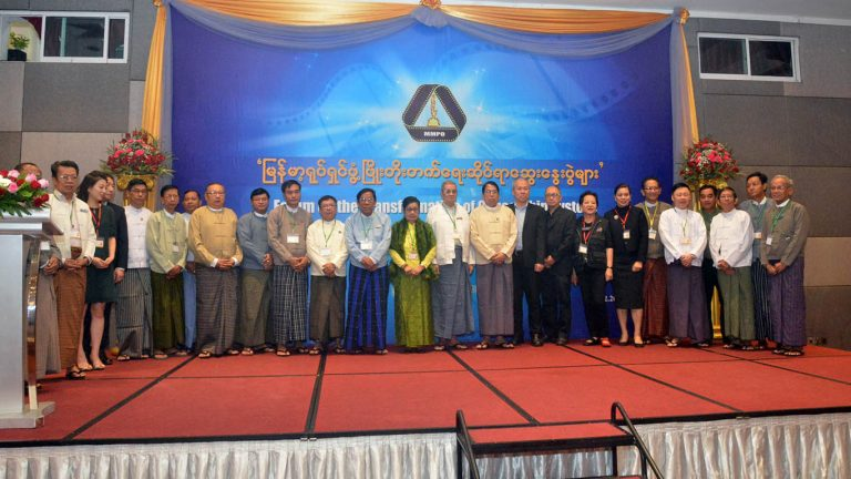 Union Minister Dr. Pe Myint poses for a documentary photo together with officials in attendance at the forum on the Transformation of Censorship System in Yangon. Photo: MNA