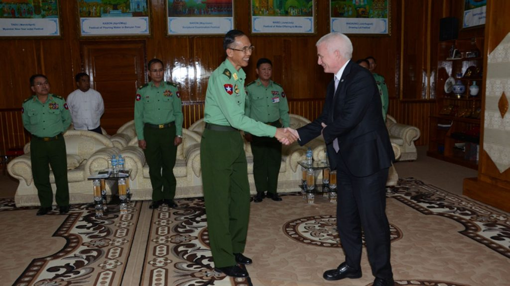 Lt-Gen Sein Win shakes hands with UN Resident Coordinator Mr Knut Ostby yesterday.Photo: MNA