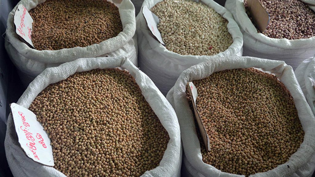 Myanmar pulses are kept on display for sale in a shop at a market. Photo: Zaw Min Latt