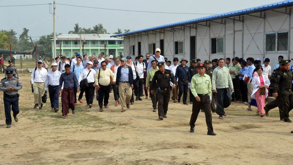 A delegation of diplomats  and UN officials led by Union Minister U Kyaw Tin, centre, in blue jacket, visits Nga Khu Ya Camp in Maungtaw, which will be used for repatriation. Photo: MNA