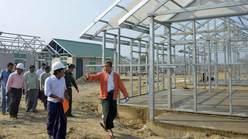 Rakhine State Chief Minister U Nyi Pu (Right) and officials inspect construction of houses for local ethnic people and returnees in Maungtaw, Rakhine State, yesterday. Photo: MNA