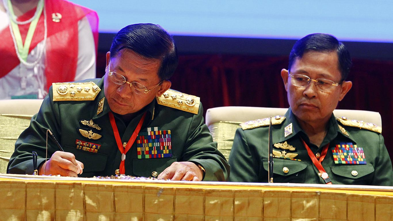 Senior General Min Aung Hlaing signs Nationwide Ceasefire Agreement in Nay Pyi Taw yesterday. Photo: MNA