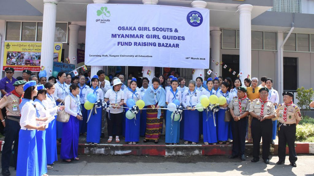 Dr. Shwe Hlwan and officials cut the ceremonial ribbons to mark the opening of the Osaka girl scouts and Myanmar girl guides fund raising bazaar in Yangon Education University.Photo: Zaw Min Latt