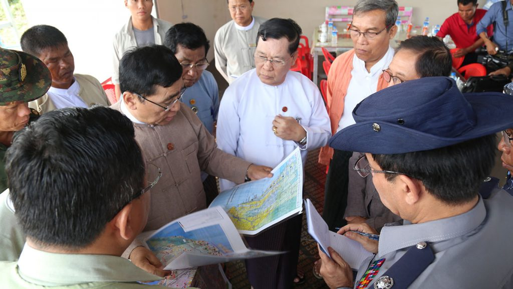 Dr. Win Myat Aye discussing the progress of UEHRD with Rakhine State Government officials.  Photo: MNA