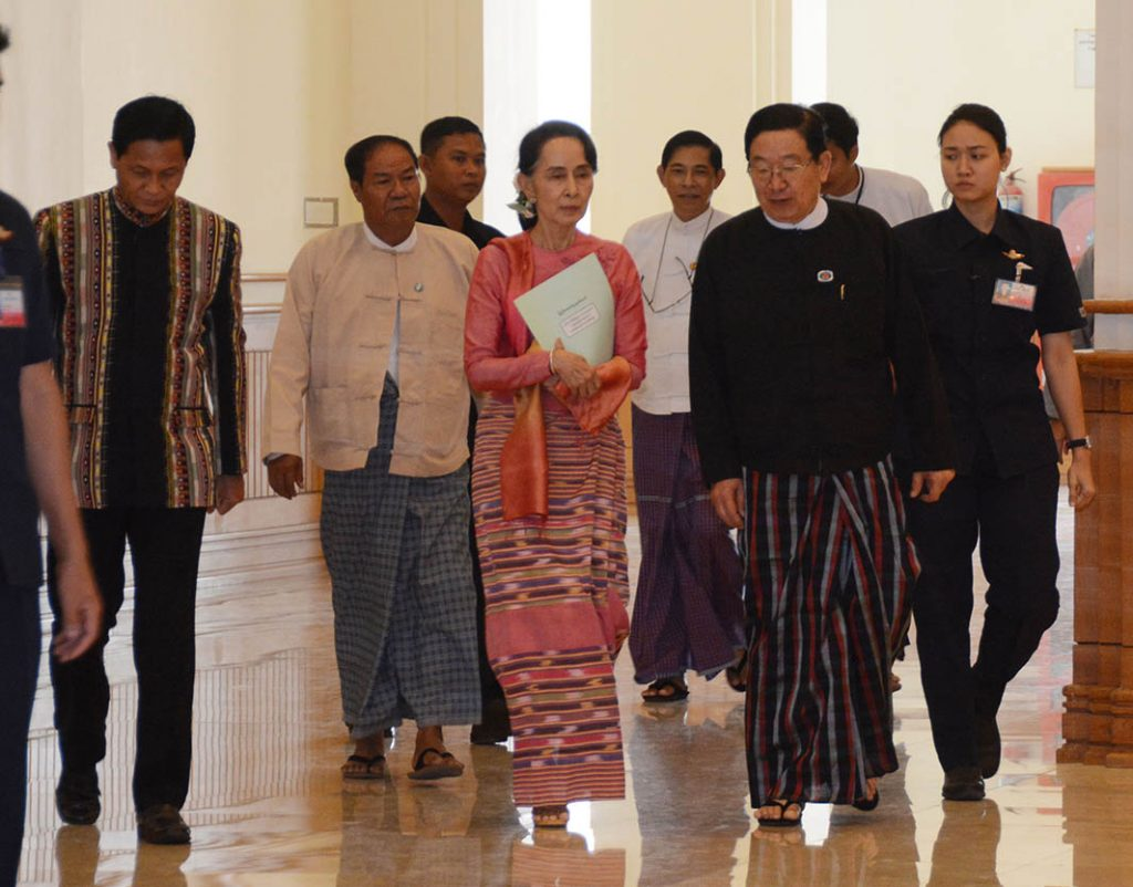 State Counsellor Daw Aung San Suu Kyi arrives Pyidaungsu Hluttaw to observe the Presidential Election yesterday. Photo: MNA
