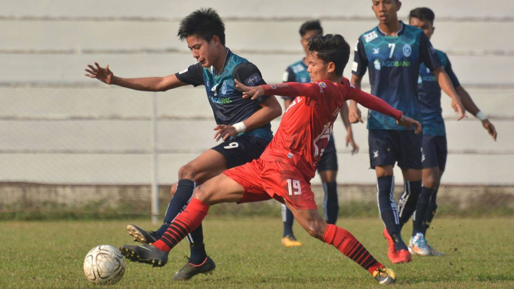 Youth players form Yangon and Shan vie for the ball in yesterday's U-21 MNL tourney at Padonmar Stadium in Yangon. Photo:YUFC
