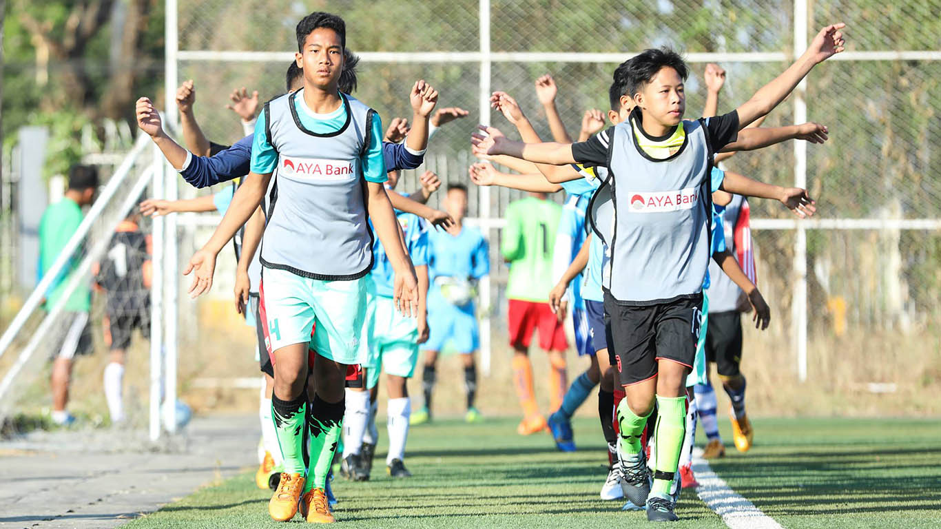 Myanmar youth footballers seen at the training field of National Football Academy in Yangon yesterday. Photo;MFF