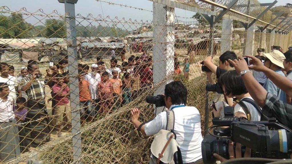 Local and foreign reporters interacting with people at the border in Rakhine State.  Photo: MNA