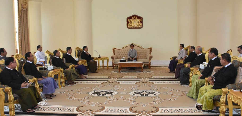 President U Win Myint, centre, meeting with Union Chief Justice U Htun Htun Oo, sixth from left, and Supreme Court Judges yesterday. Photo: MNA
