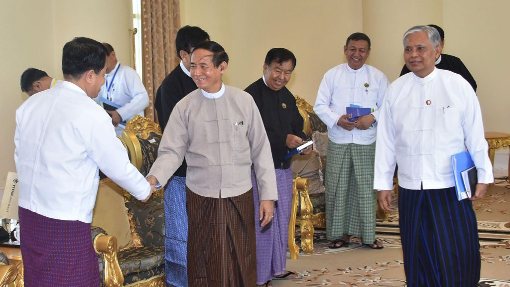 President U Win Myint, center, shakes hands with a member of the Anti-Corruption Commission in a meeting yesterday. Photo: MNA