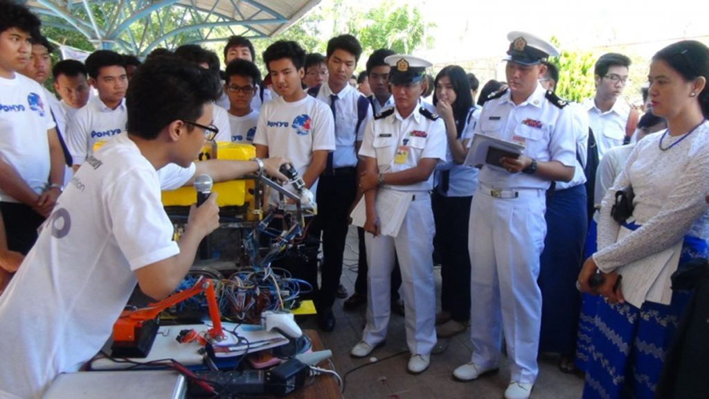 A Maritime University student explains his project at the ROV (Remotely Operated Vehicle) competition in Yangon.