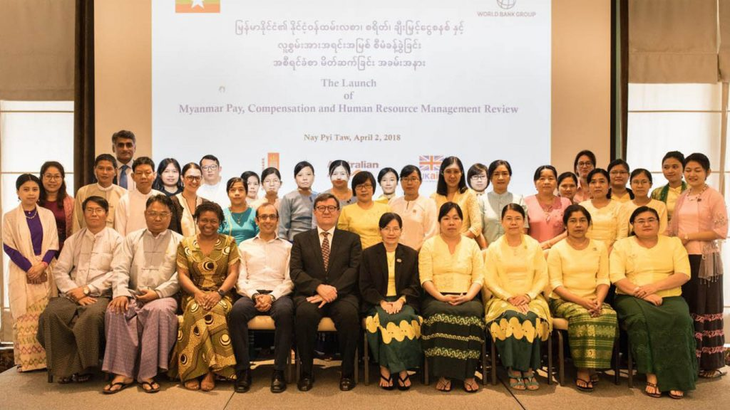 Participants pose for the documentary photo at the launching ceremony of Myanmar Pay, Compensation and Human Resource Management Review in Nay Pyi Taw on 2 April.Photo: GNLM