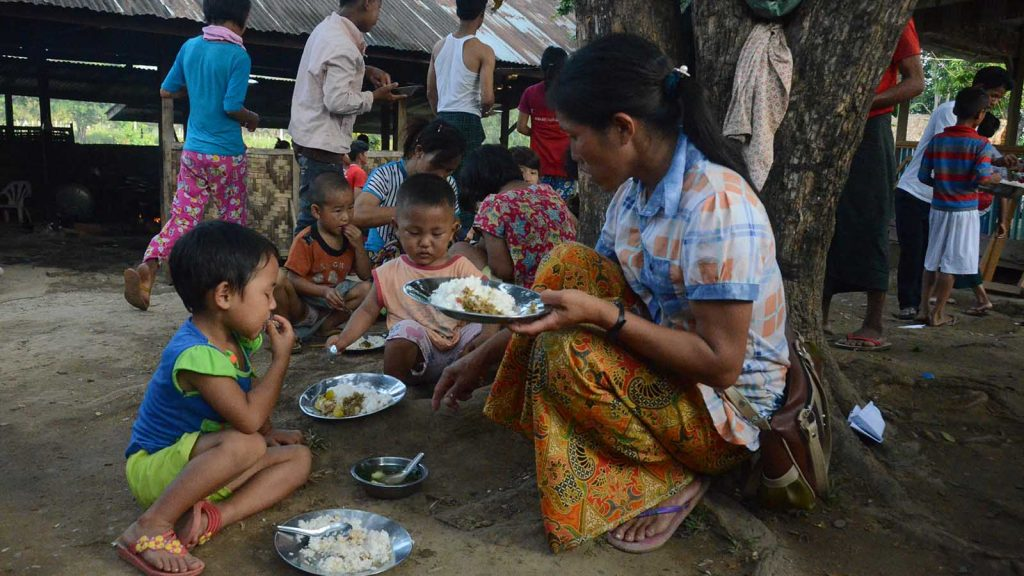 Families taking temporary shelter in Trinity Baptist Church in Naung Nan Village eating dinner.
