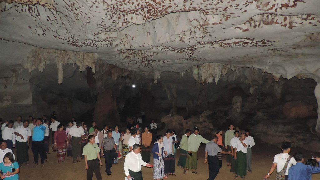The Kayin State Chief Minister and entourage walk along the natural pathway in Esathara limestone cave. photo: nay myo lwin (district iprd)