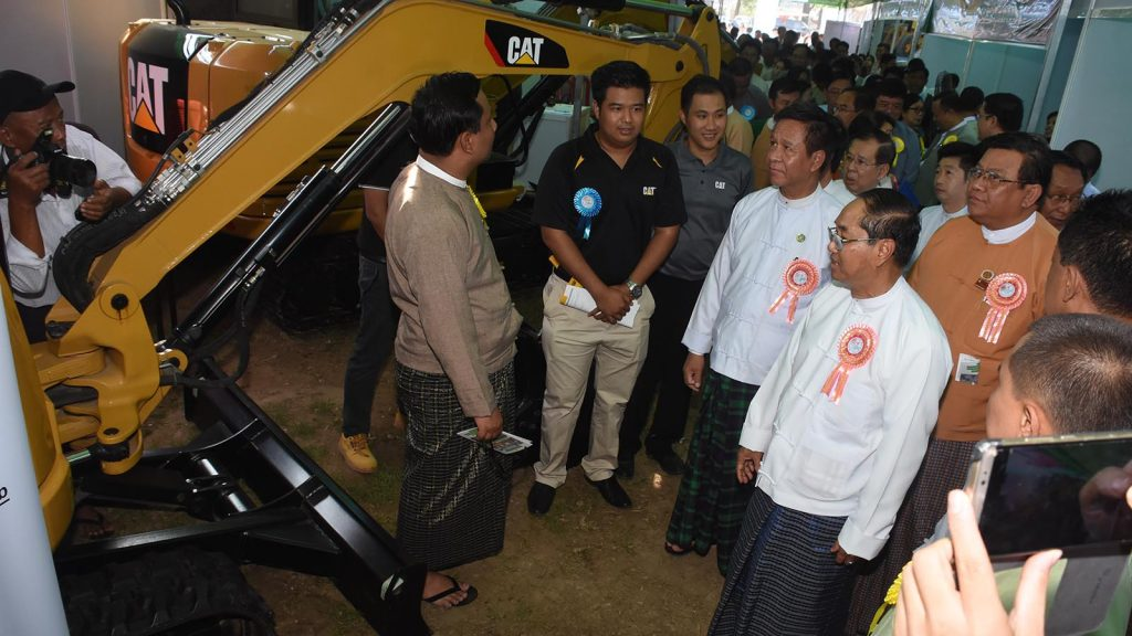 Vice President U Myint Swe visits the booth at MSMEs exhibition in Pathein, Ayeyawady Region.Photo: MNA