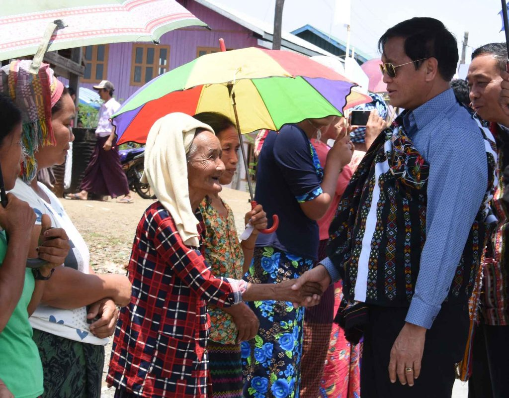 Vice President U Henry Van Thio welcomed by local residents in Bonzone village in Haka Township. Photo: MNA