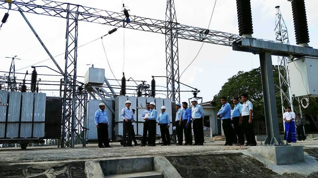 Deputy Minister for Electricity and Energy Dr. Tun Naing and party inspect an electrification facility. Photo: mna