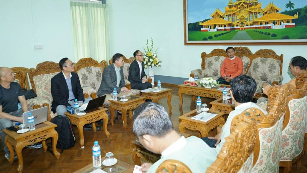 Bago Region Chief Minister discusses construction of a paper production plant with Lee & Man Manufacturing Co. Chairman.photo: Tin SOe