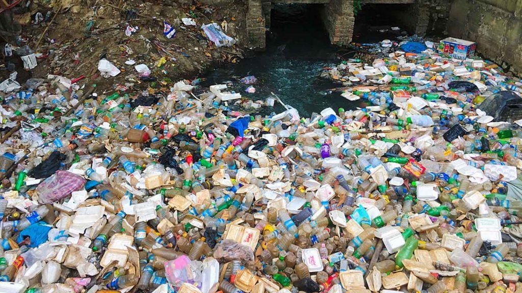 Plastic clogs up a waterway in Yangon, Myanmar.