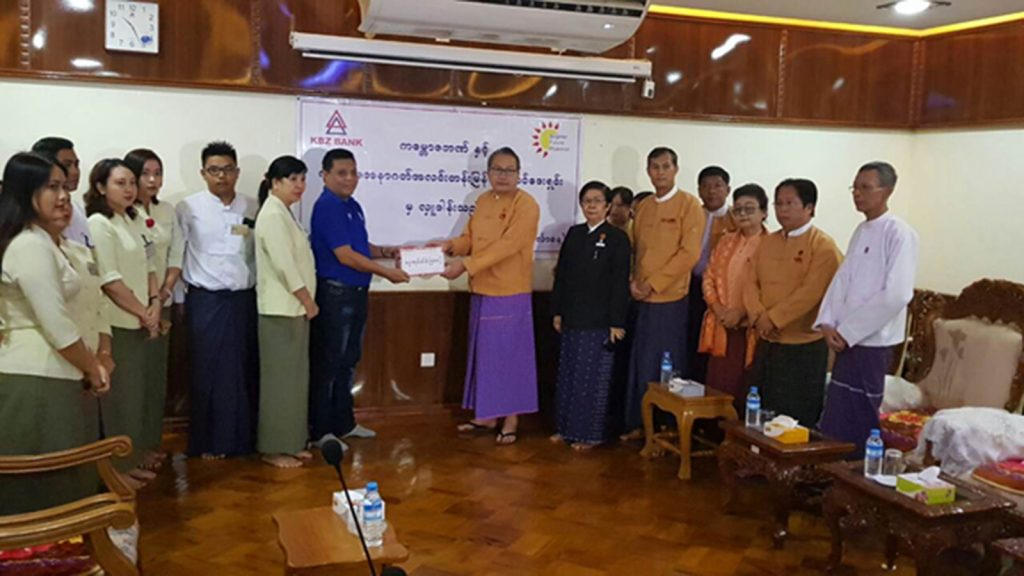 Mon State Chief Minister Dr. Aye Zan accepts the donation from Brighter Future Myanmar Foundation representatives.Photo: Supplied