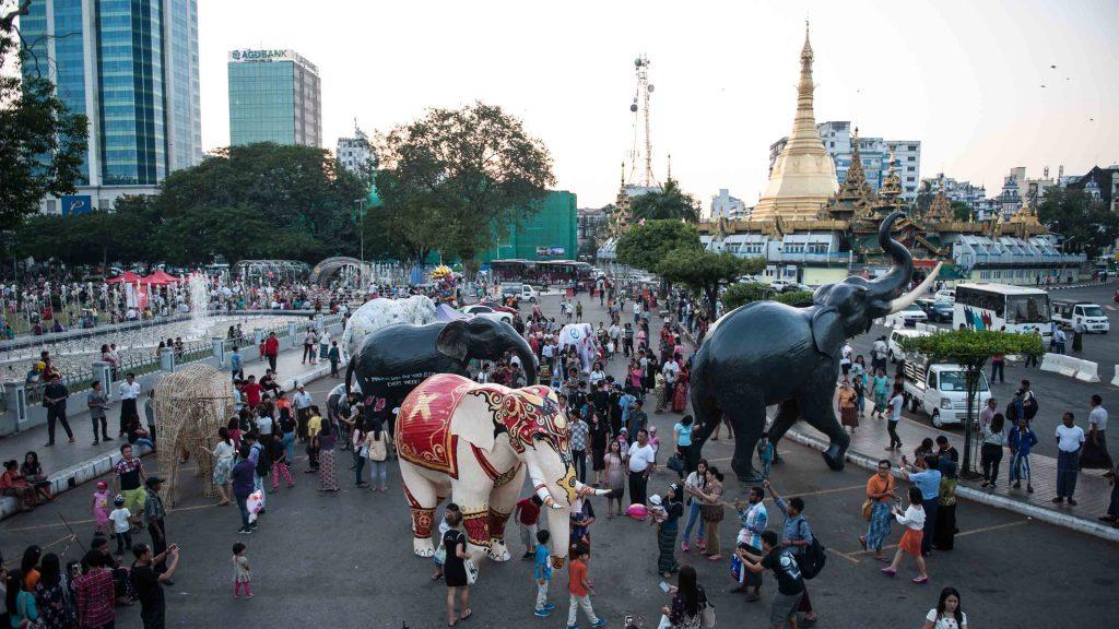 People enjoy elephant sculptures displayed at Maha Bandoola Park near Sule Pagoda in downtown Yangon.Photo: Supplied