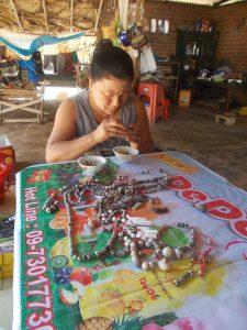 A woman arranges Pyu bead necklaces . Photo: Nway Nadi (Myitnge)