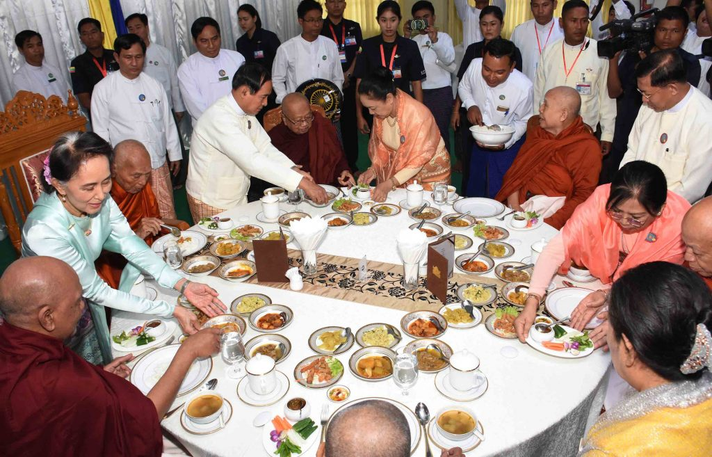 President U Win Myint, First Lady Daw Cho Cho and State Counsellor Daw Aung San Suu Kyi offering 'soon' to Sayadaws as part of the Waso robe offering ceremony. Photo: MNA