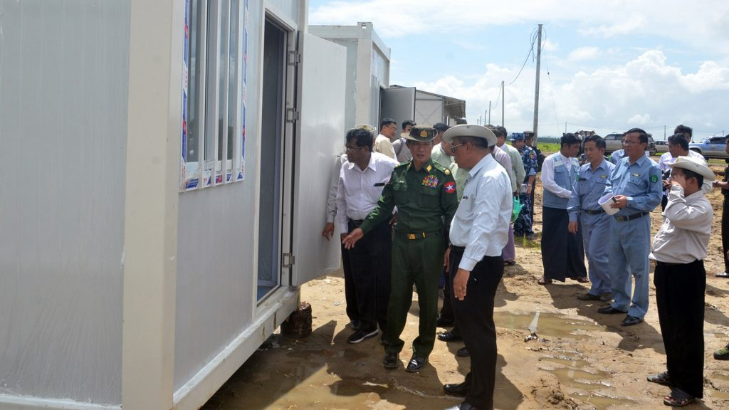Officials inspect modular houses at Hla Phoe Khaung Transit Centre.Photo: Min Thit (MNA) and Ko Min