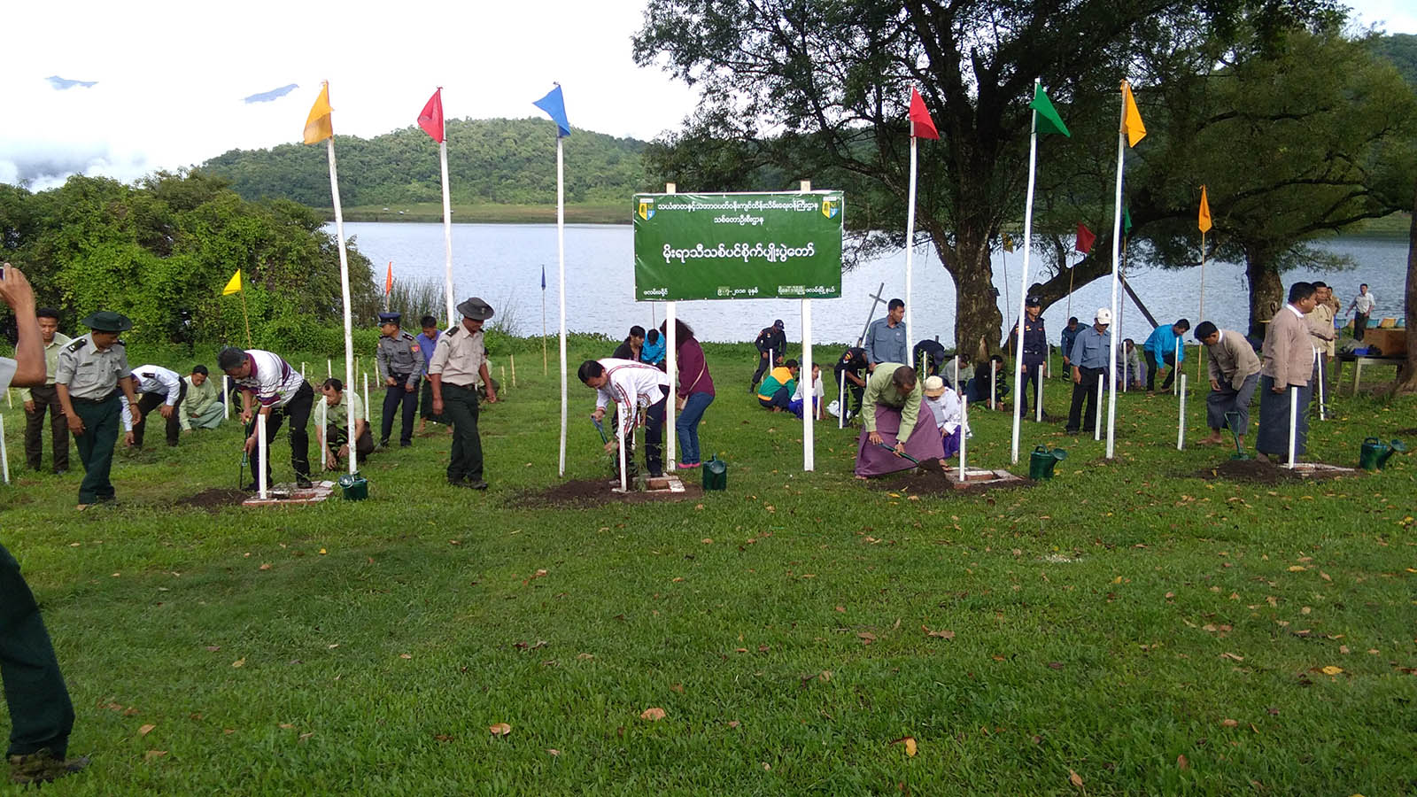 Departmental officials plant saplings in Reedhorda, a border town in Chin State.  Photo: Township IPRD