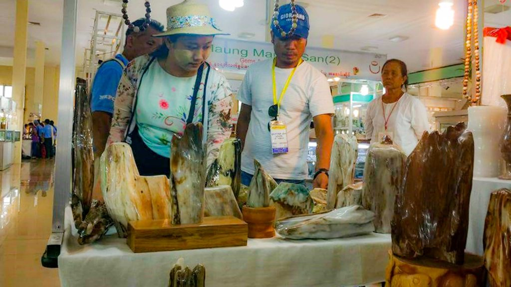 Customers viewing jade stones at a gems and jewellery shop in Mandalay . Photo: Thurein