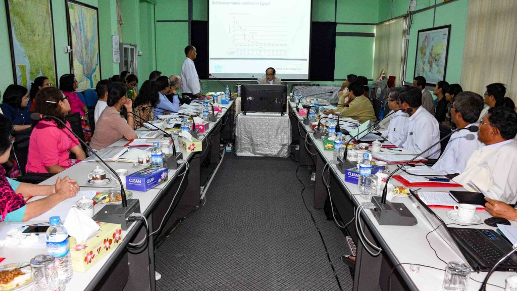 Minister for Health and Sports Dr Myint Htwe attends a meeting during which  WHO pledged to provide medical supplies and technical aid to prevent the outbreak of snail fever.Photo: Supplied