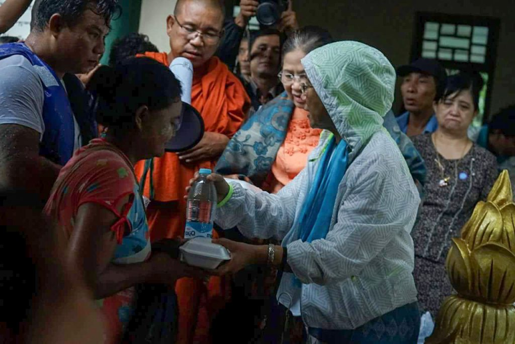 The Orphans Reduction and Protection Association delivers water bottles and meal packs to flood victims in  Bago yesterday. Photo: Bago District IPRD