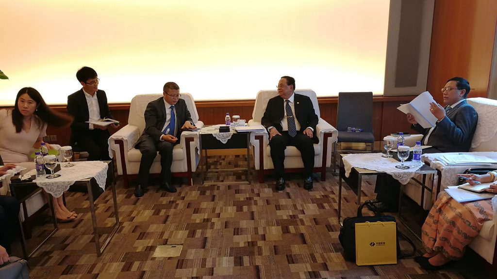 Union Minister U Win Khaing discusses with TBEA Company Limited President Mr. Huang Hanjie in Beijing.Photo: MNA