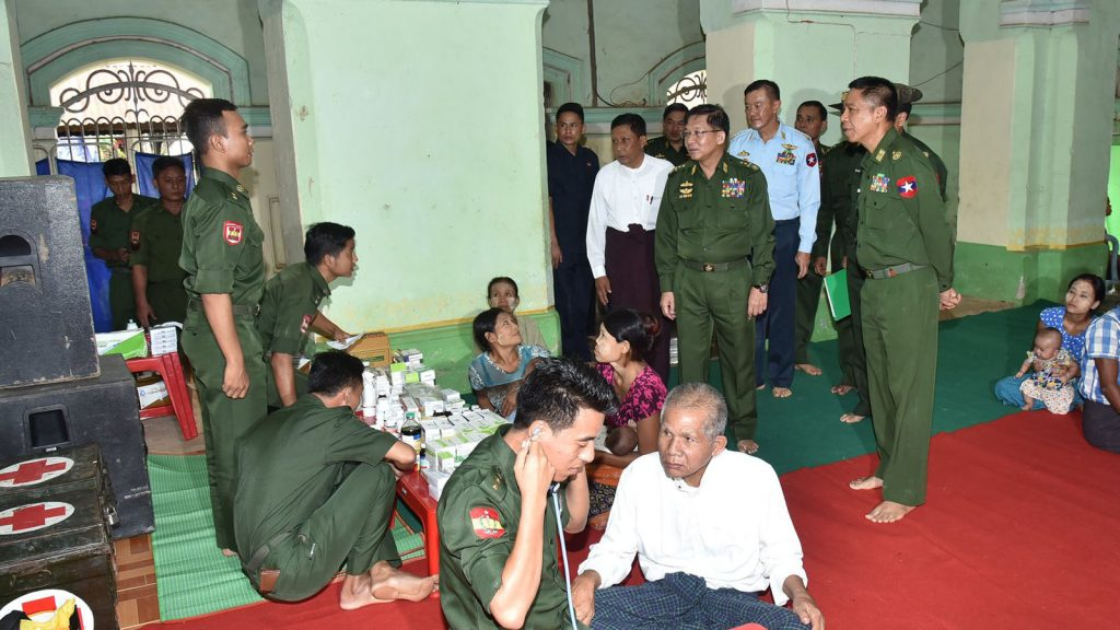 Senior General Min Aung Hlaing inspects mobile military medical team providing health care to flood victims in Shwekyin Township, Bago Region, yesterday.Photo: MNA