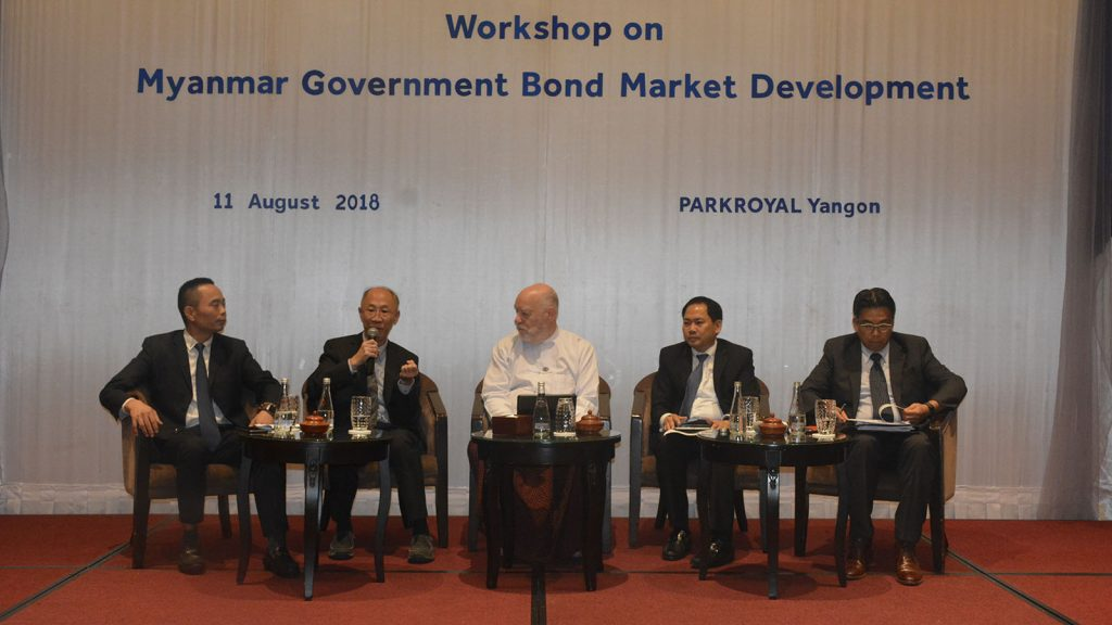 Officials from the various organizations and government departments involved in the Myanmar-Japan Joint Committee discuss developing the bond market at the committee's fourth workshop.Photo: MNA