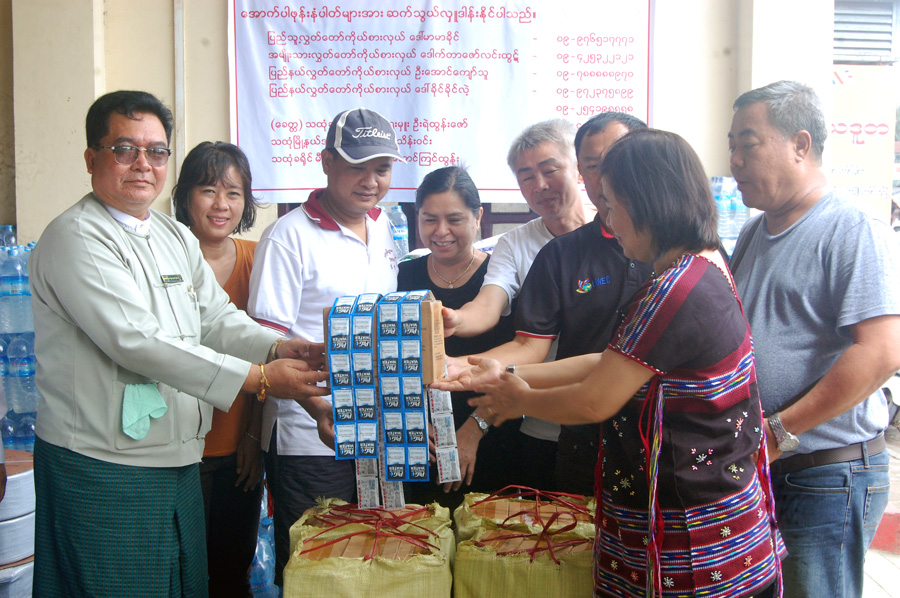 An official receives water purication tablets boxes for flood victims  in Thaton. Photo: Thet Oo (Thaton)