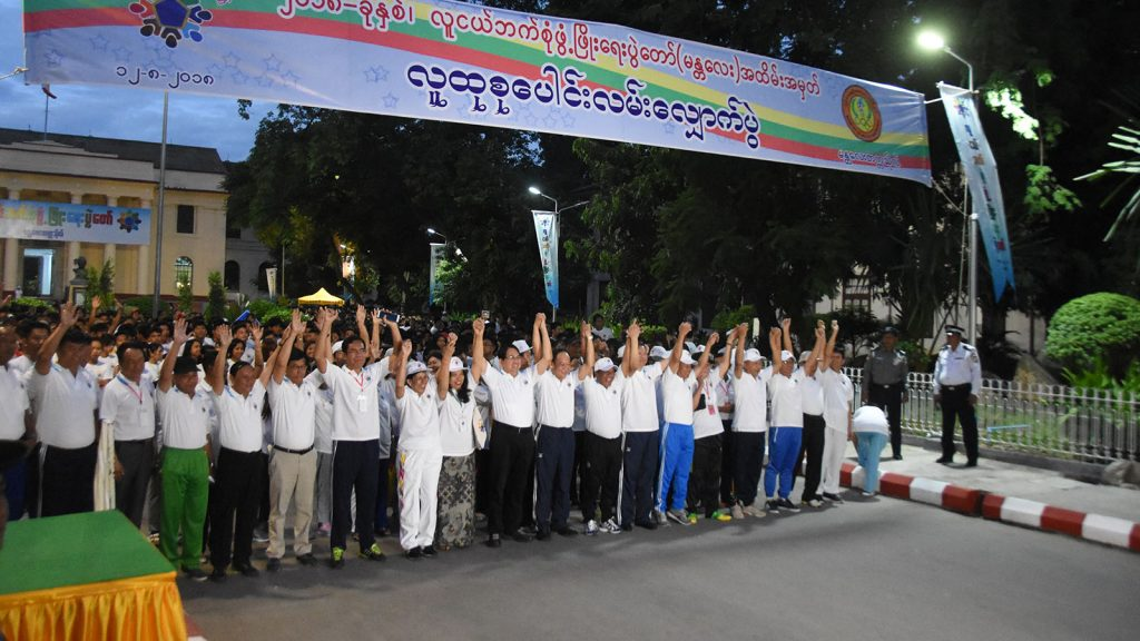 Participants in the early morning walk seen at the starting point in front of the Main Hall of the University of Mandalay. The mass walking event was held to mark the All-Round Youth Development Festival (Mandalay). Photo: Myanmar News Agency