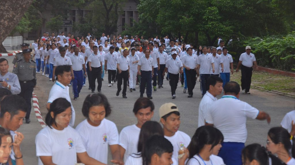 Union Minister Dr. Pe Myint, government officials, teachers and students from various regional universities and colleges actively participate in the early morning walk along the University of Mandalay's circuit, leading up to the All-Round Youth Development Festival to be held in the university's premises later in the day. photo: myanmar news agency