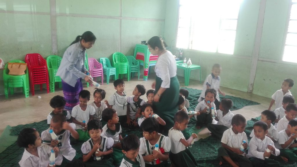 Teachers treat students with milk and dairy products at a school. Photo: Zeyatu (Magway)