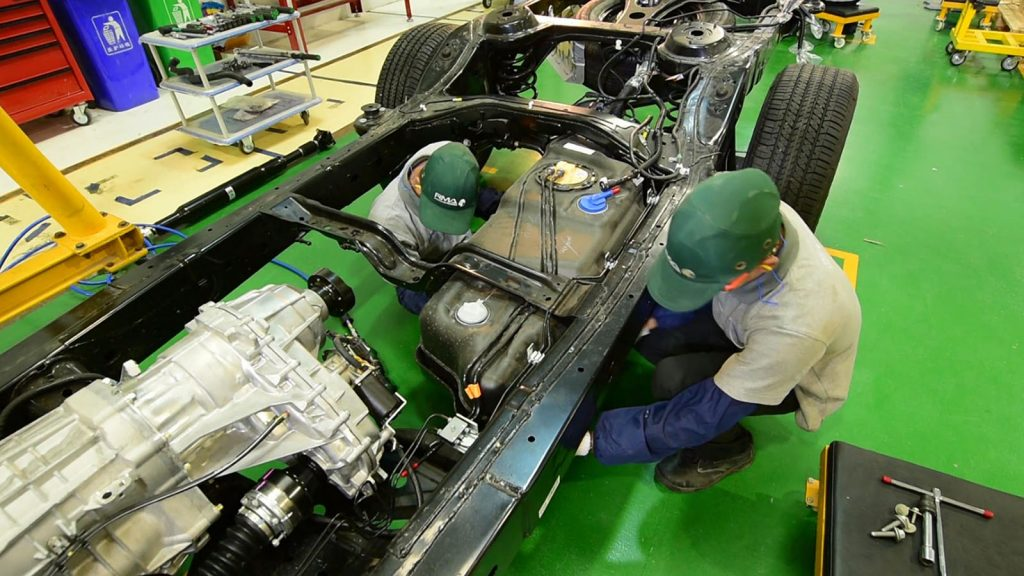 Workers fix parts to Ford vehicle in a factory in East Dagon Myothit, Yangon.Photo: Supplied
