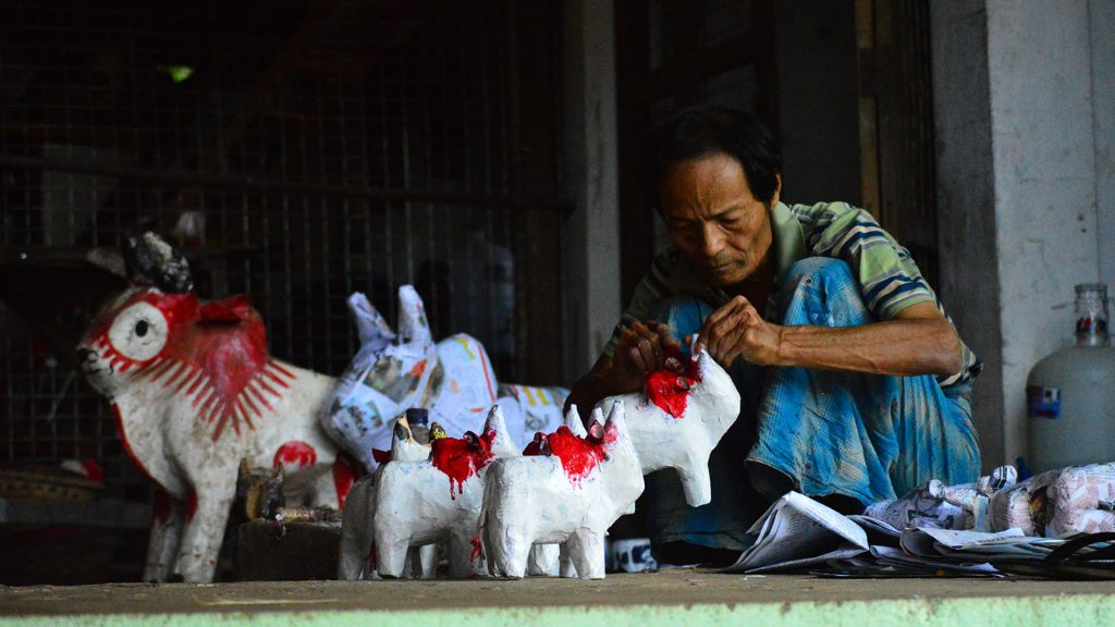 While demand for some traditional animal papier mâché toys is falling fast, papier mâché cows are still popular for children in Myanmar.  Photo: Aye Min Soe
