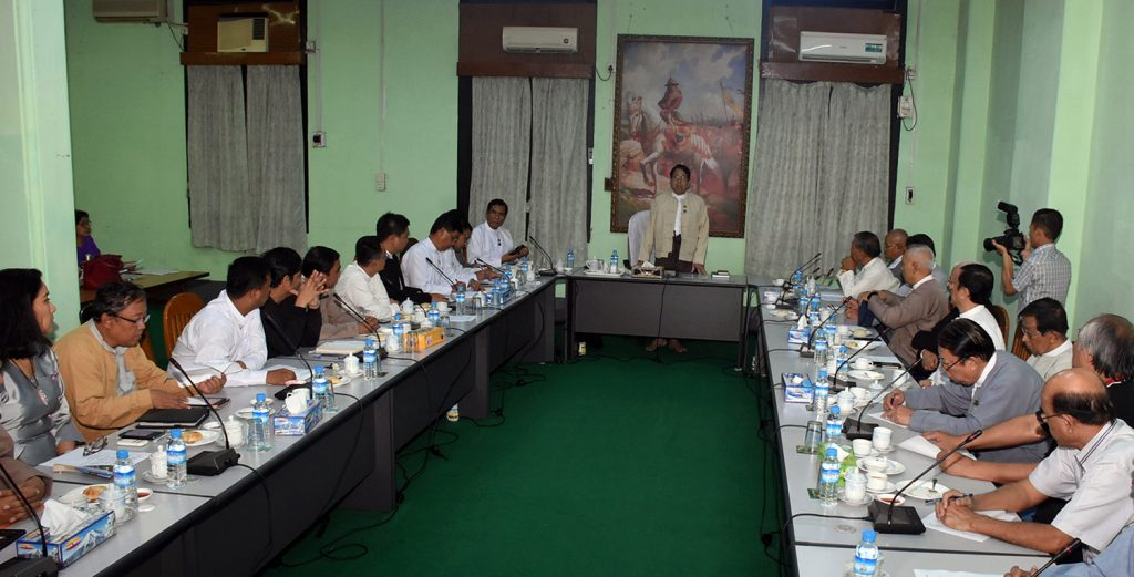 Union Minister Dr. Pe Myint addresses the meeting with newly elected Myanmar Press Council members in Yangon yesterday.Photo: MNA