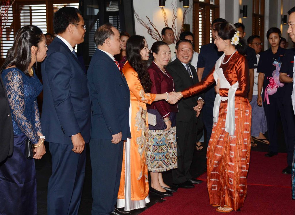 State Counsellor Daw Aung San Suu Kyi greets ASEAN Ambassadors and their spouses at the luncheon to commemorate the 51st Anniversary of ASEAN Day in Nay Pyi Taw yesterday. Photo: MNA