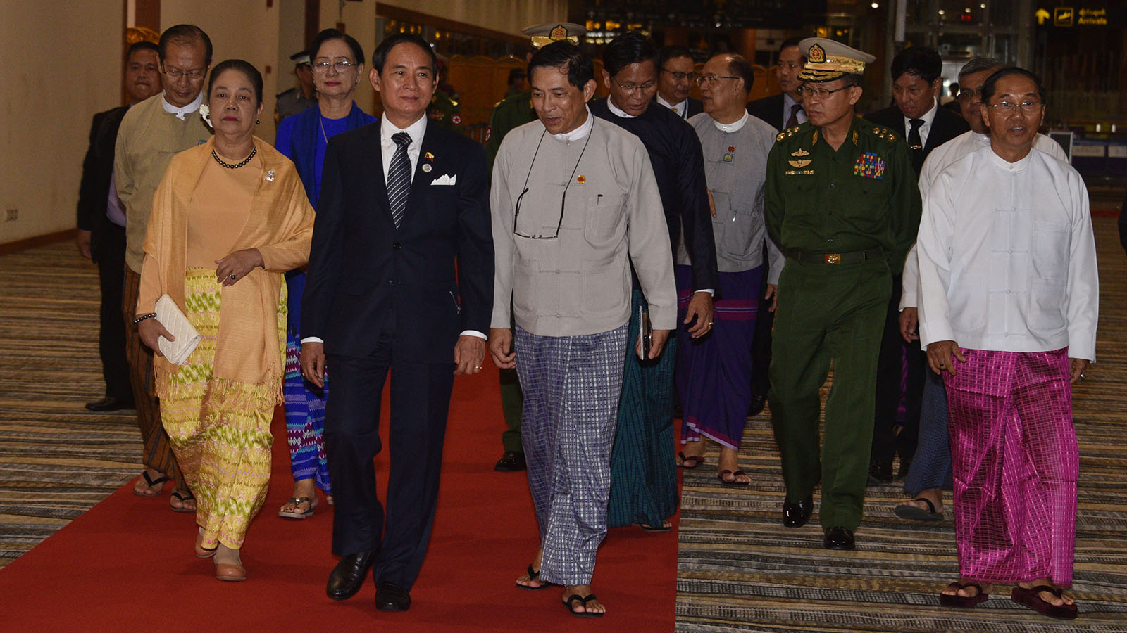 President U Win Myint and the First Lady are welcomed by officials at Nay Pyi Taw International Airport yesterday. Photo: MNA