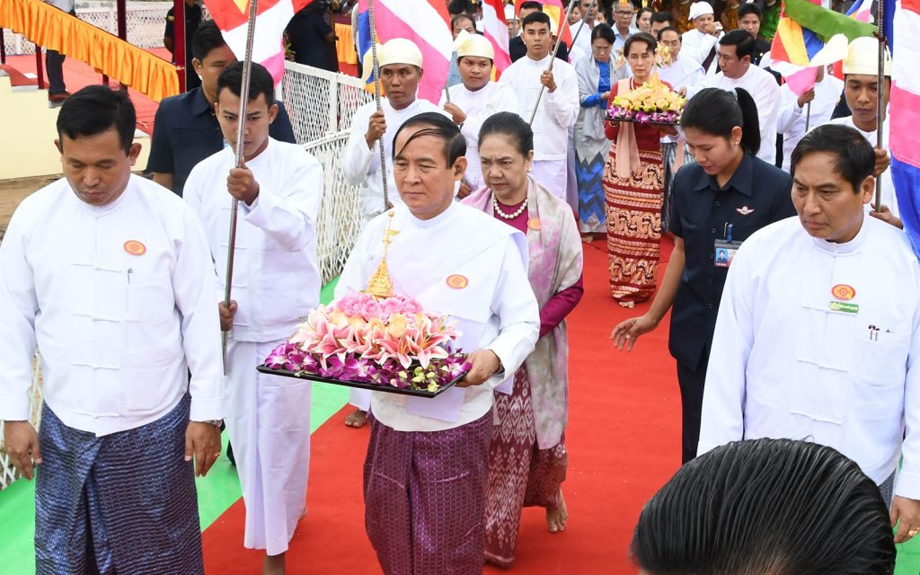 President U Win Myint and First Lady Daw Cho Cho convey religious objects at the ceremony to enshrine the objects at Eternal Peace Pagoda.