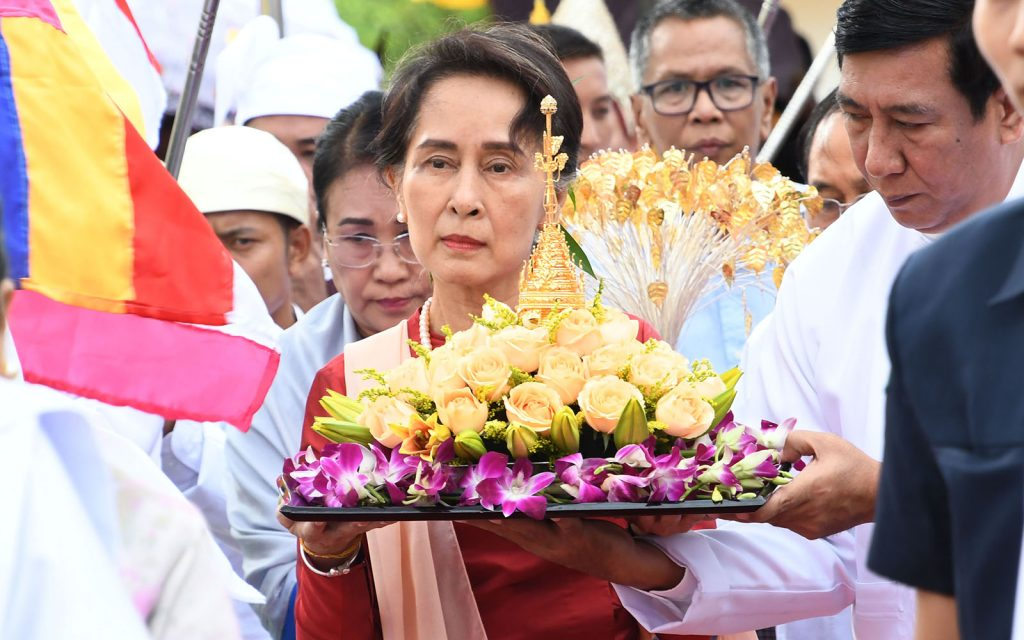 State Counsellor Daw Aung San Suu Kyi conveys religious object at the ceremony to enshrine the objects at Eternal Peace Pagoda. Photo: MNA