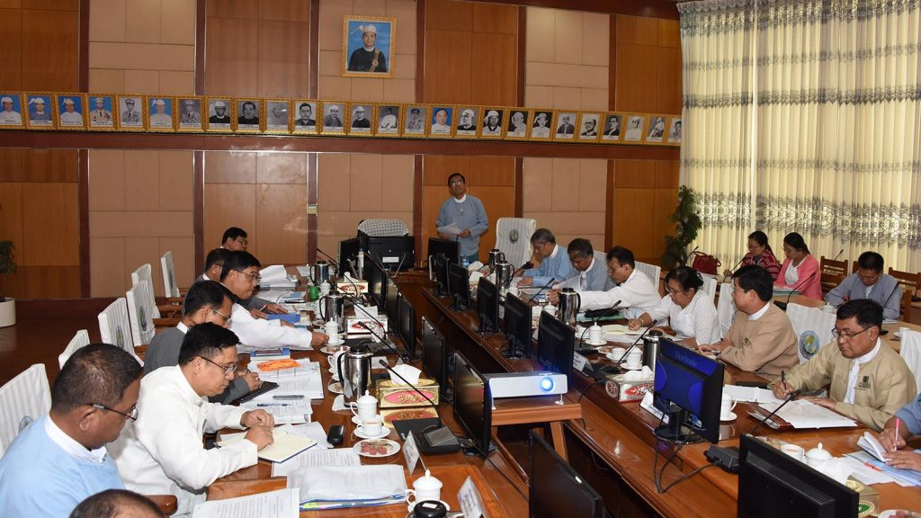Deputy Minister U Aung Hla Tun addresses the coordination meeting of school textbook tender accepting and assessment committee yesterday.Photo: MNA