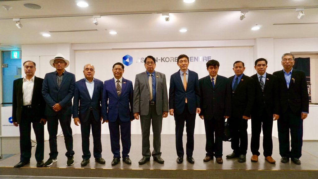 Union Minister for Information Dr. Pe Myint poses for a photo together with officials from the ASEAN-Korea Centre in Seoul yesterday.Photo: MNA