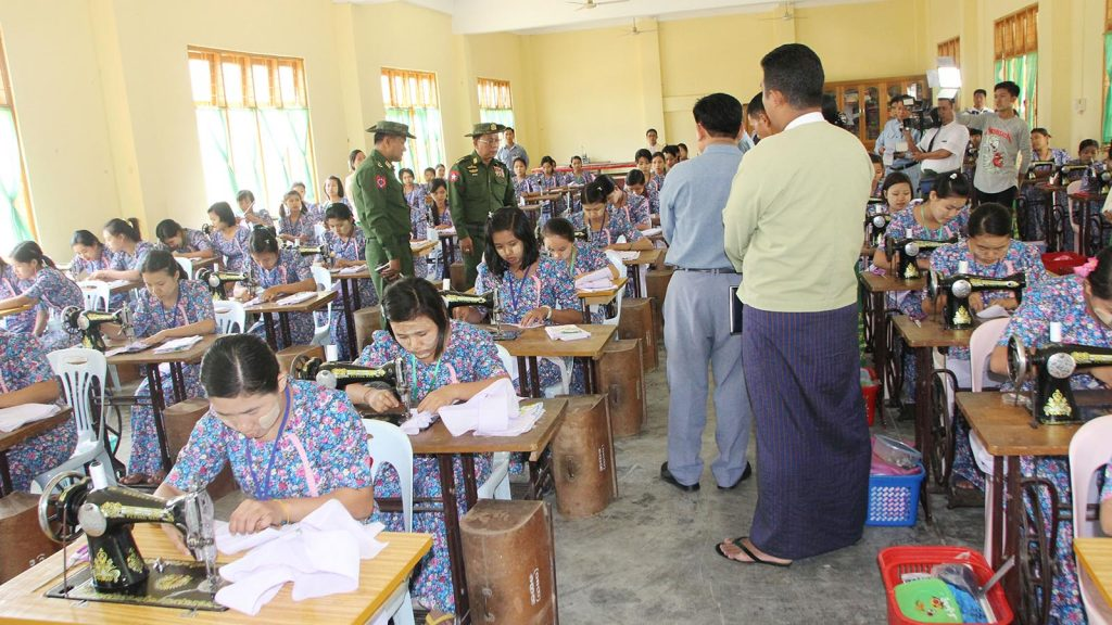 Union Minister Lt-Gen Ye Aung inspects trainees attending sewing skills at women vocational training school.Photo: Myanmar New Agency